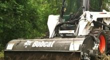 Колесный мини погрузчик Bobcat S550 крупным планом
